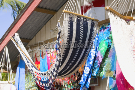 hammocks hanging at a market stall