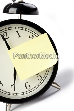 alarm clock and note paper