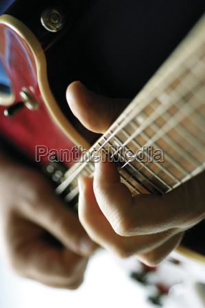 close up of man playing electric