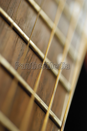 extreme close up of guitar frets
