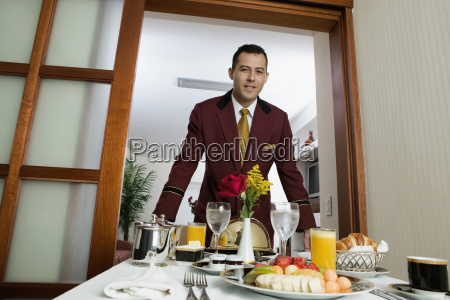 portrait of a waiter serving food