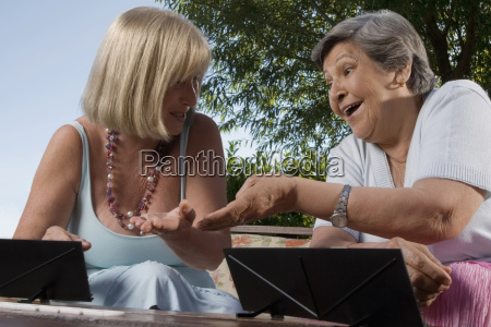 two senior women playing games and