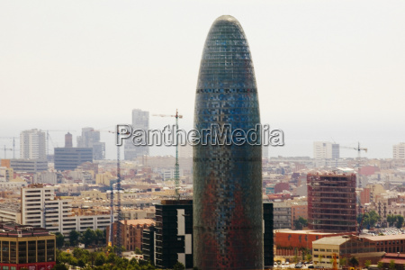 tower in a city torre agbar
