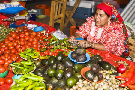 mid adult woman selling vegetables tlacolula