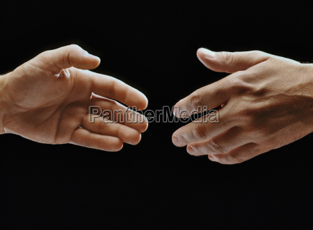 close up of two hands reaching