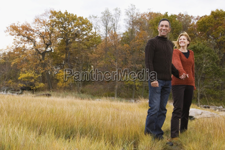 mature couple standing on the grass