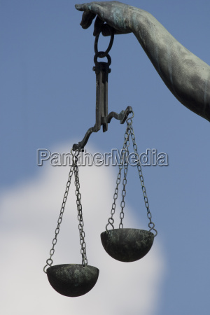 scales of lady justice fountain at