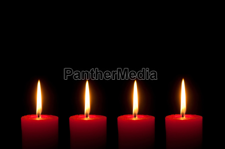four red candles black background
