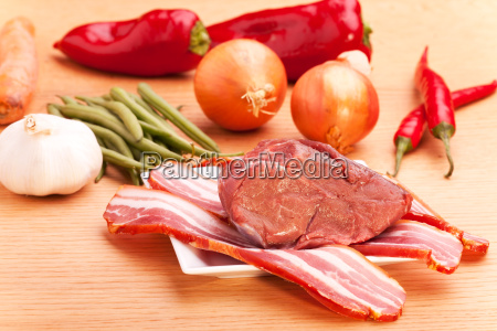 bacon raw meat and on a