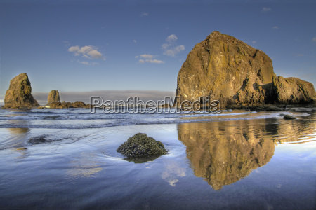 reflection of haystack rock at cannon