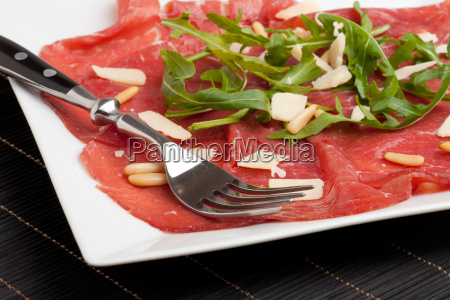 carpaccio with parmesan and pine nuts