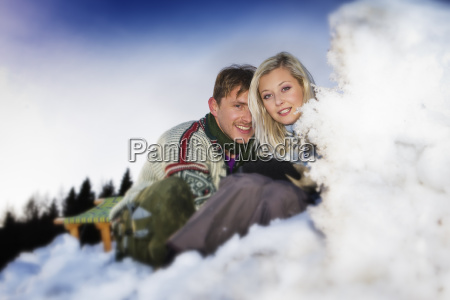 couple snuggling in the snow