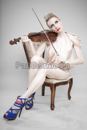 glamorous woman with violin