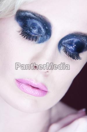 woman with dark eye makeup