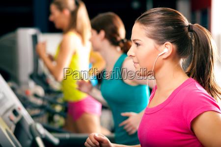 people running on treadmill at the