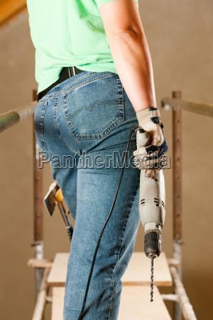 heimwerkerin with drill
