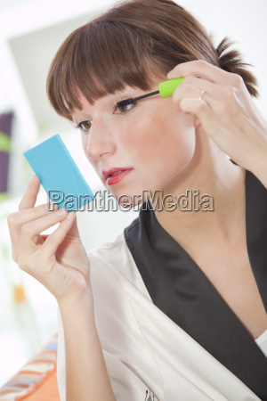 woman putting make up for eye