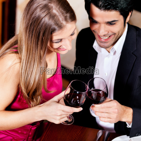 couple in restaurant with wine