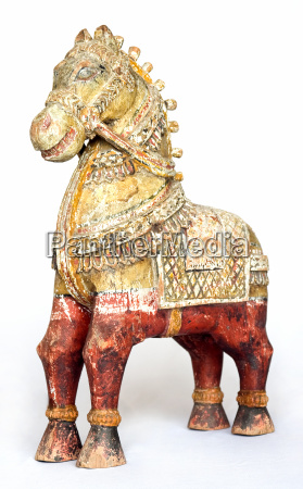 old wooden harnd carved horse