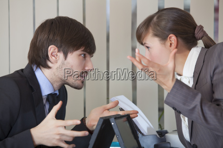two office workers in conflict