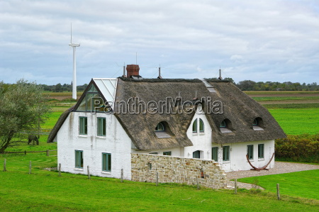 north sea farmhouse with a thatched