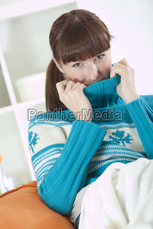 woman in sweater at home
