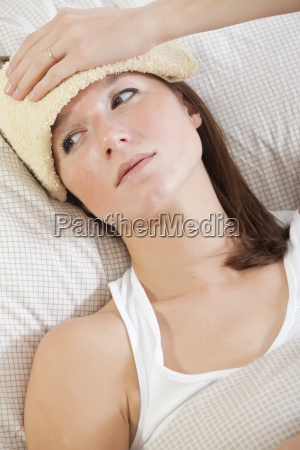 woman with high fever in bed