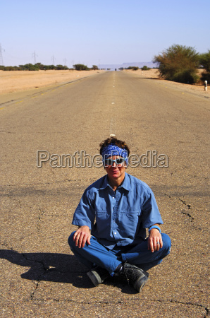 young woman sitting cross legged in