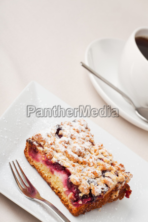 crumb cake and a cup of