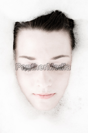woman relaxes in bathtub