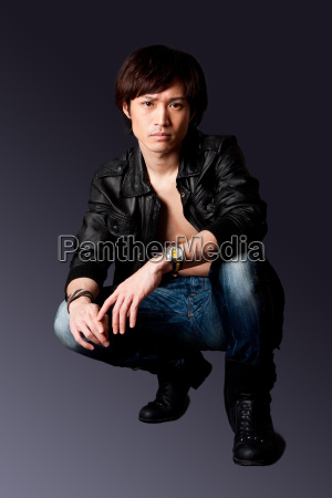 handsome asian man with leather jacket