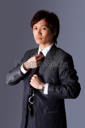 successful, asian, business, man, fixing, tie - 3986461