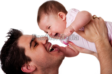 happy laughing father and baby daughter