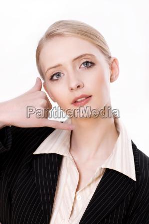 a woman shows a gesture telefowania