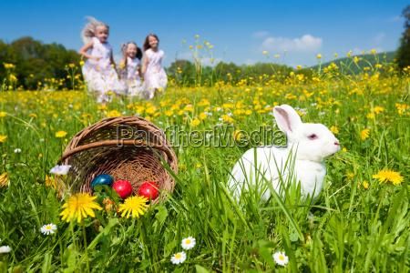 children on easter egg hunt with