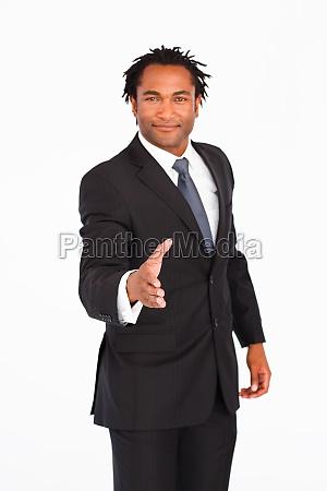 serious businessman greeting with handshake