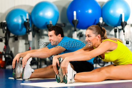 couple in the gym during stretching