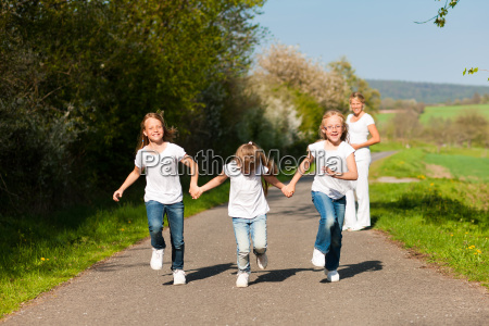 children running mother is pregnant