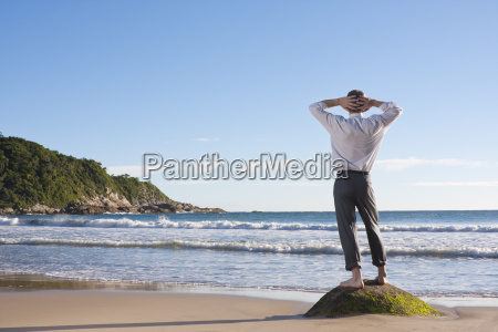 business man relaxed at the beach