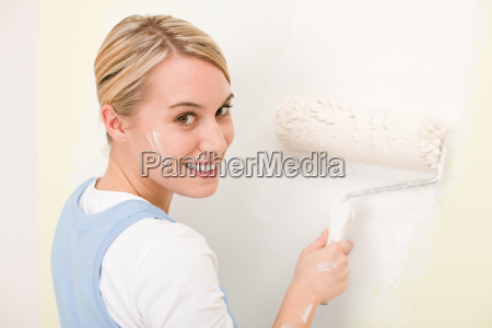 home improvement handywoman painting wall