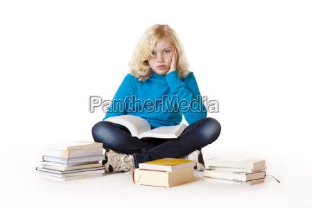 schoolgirl sitting frustrated on floor
