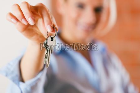 estate agent handing keys