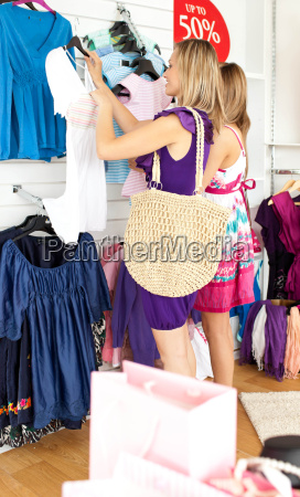 two radiant women selecting item