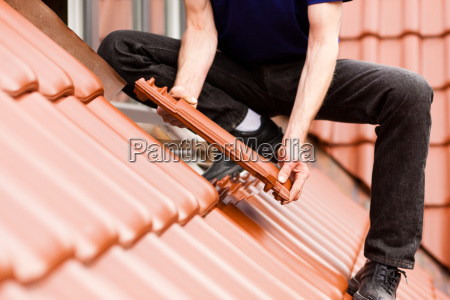 roofing covers a roof with tiles