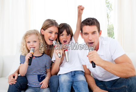 portrait of a lively family singing