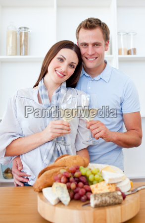 happy couple drinking white wine