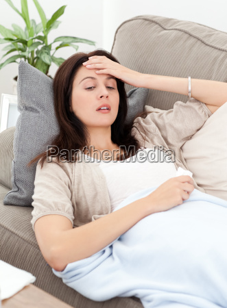 sick woman lying on the sofa