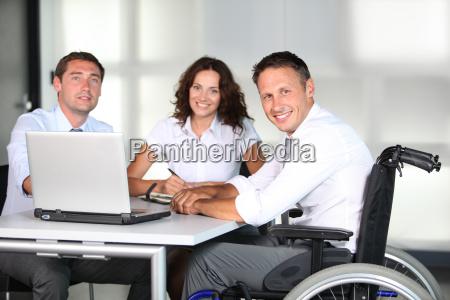 businessman in wheelchair working in the