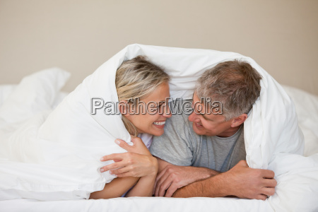 couple lying down in their bed