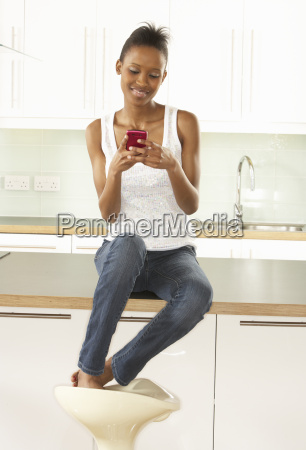 woman using mobile phone sitting in